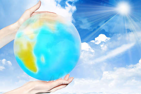 abstract scene of the planet in feminine hand photo