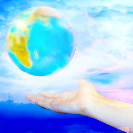 abstract year landscape with hand and planet photo