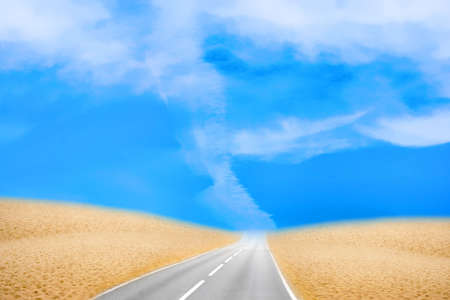 road in desert under blue sky photo