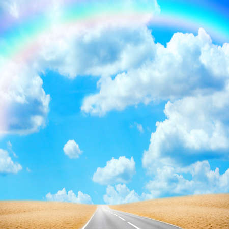 road in desert under sky with rainbow photo
