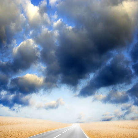 road in desert under beautiful year blue sky photo