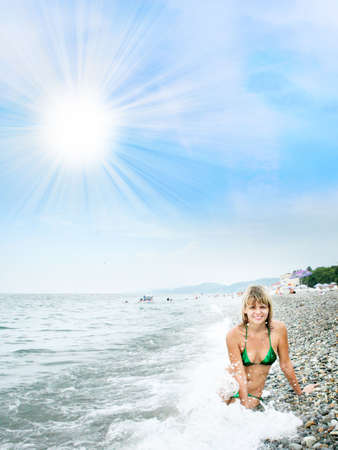 denuded: ual girl on sea beach under shining sky