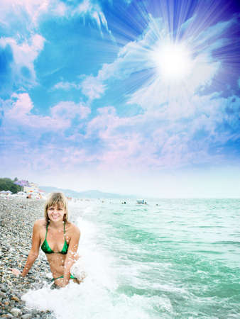 girl on sea beach under shining sky photo
