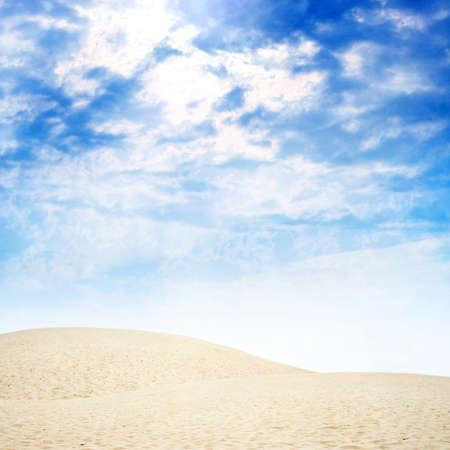 dune: sandy sun dune in desert on background sky Stock Photo