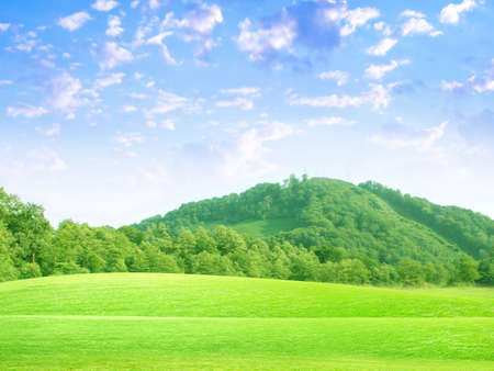 overhand: abstract sky overhand green meadow on hill Stock Photo
