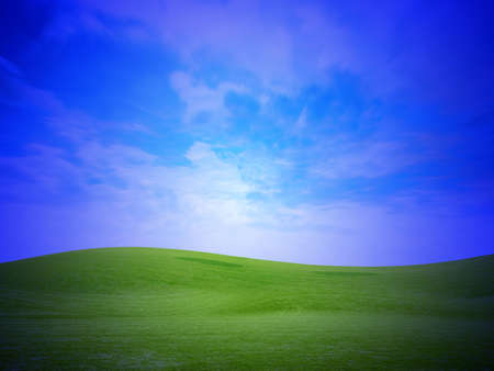 abstract sky on green meadow on hill photo