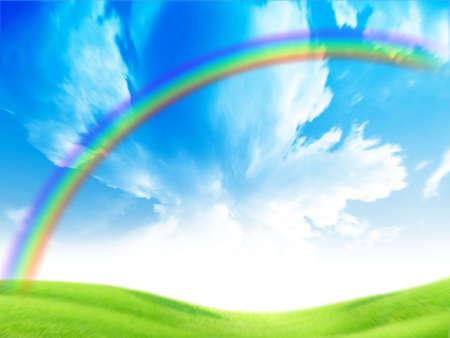 green landscape and rainbow on solar sky photo
