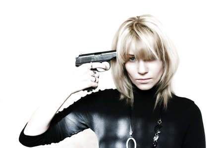 beautiful girl with pistol at hand  photo