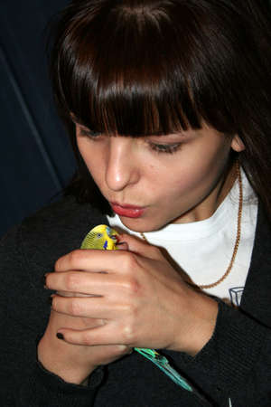 younger woman and green parrot photo