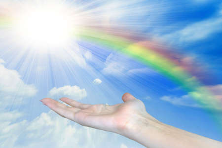 rainbow on hand of the person on background shining sky  Stock Photo - 6562494
