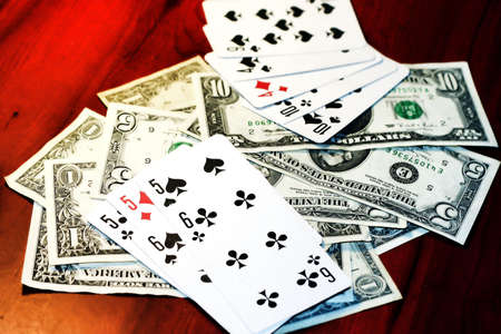 dollars and playing cards on table in casino Stock Photo - 6592803