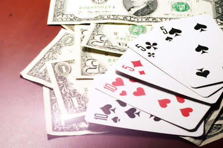 photo of accessories: dollars and playing cards on table in casino Stock Photo