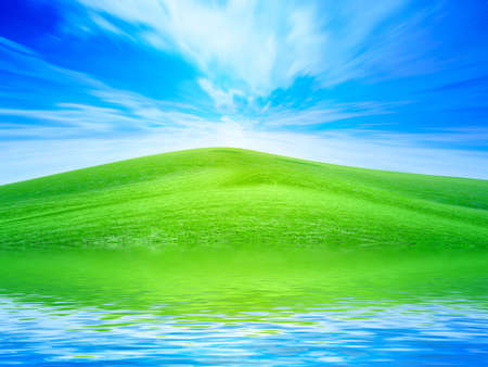 reflection of the meadow in surfaces lake Stock Photo - 7549899