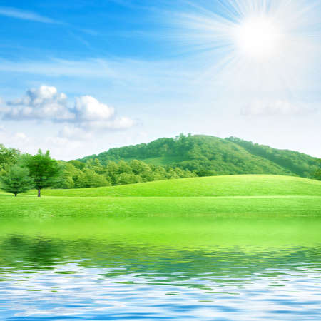 reflection of the hill in surfaces lake Stock Photo - 7544946