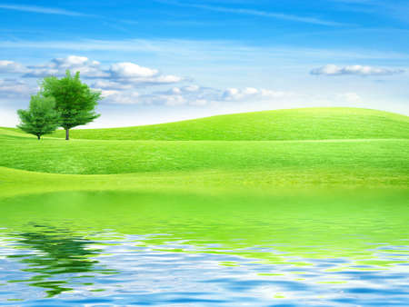 reflection of the meadow in surfaces lake Stock Photo - 7549900