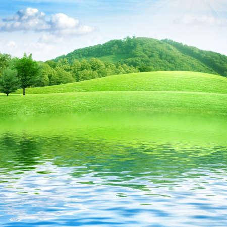 summer landscape with river and blue sky  Archivio Fotografico