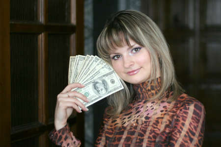 girl with money in hands photo