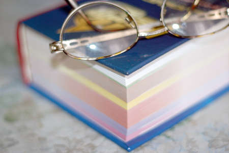 spectacles and sheets of the miscellaneous colour in new book Stock Photo - 9706216