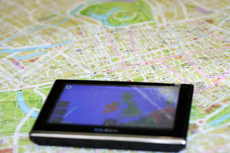 gps navigator on the map as background travel Stock Photo - 9340408