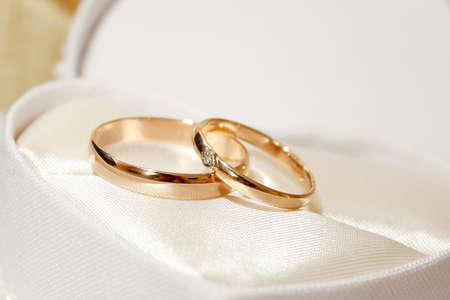 golden ring: abstract scene with wedding rings as celebration background
