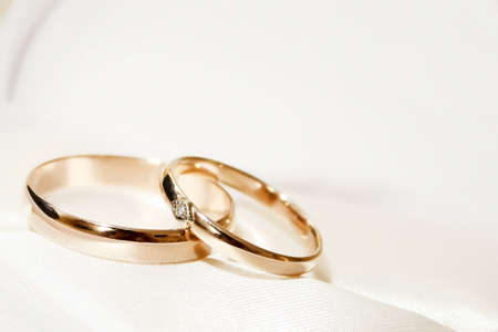 silver wedding anniversary: abstract scene with wedding rings as celebration background