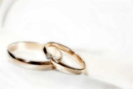 married together: wedding rings as celebration background Stock Photo