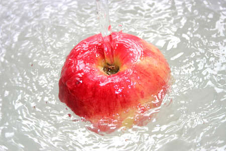 scene red apple in current water photo