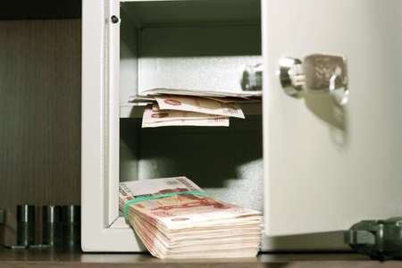 glow banknotes on shelf safe photo
