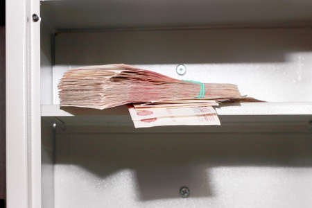 scene banknotes on shelf safe photo