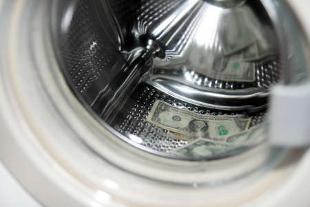american dollars in the drum washing machine photo