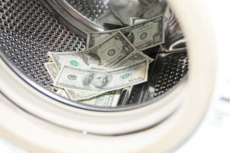 dollars in the washing machine photo