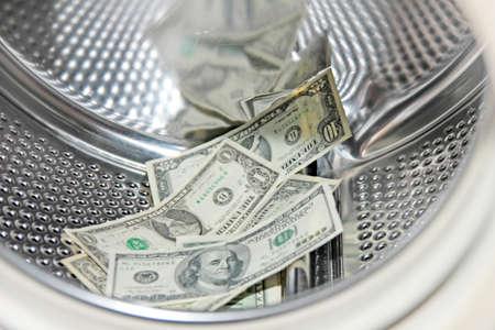 american dollars in the drum washing machine photo