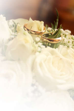 abstract scene with wedding rings and floral background
