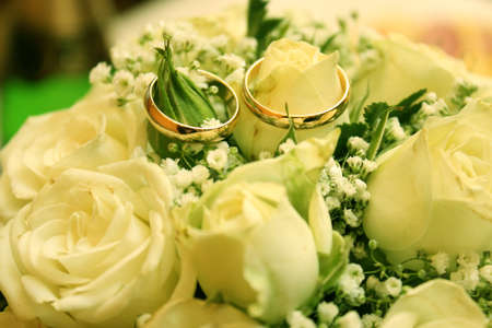 abstract scene with wedding rings and floral background  photo