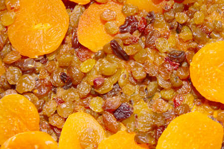 abstract scene raisins and dried apricots as background photo