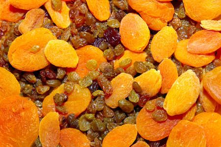 abstact scene with raisins and dried apricots as background photo