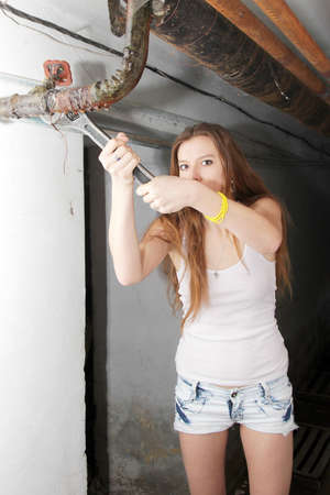 beautiful girl will use for repair wrench Stock Photo - 12933237