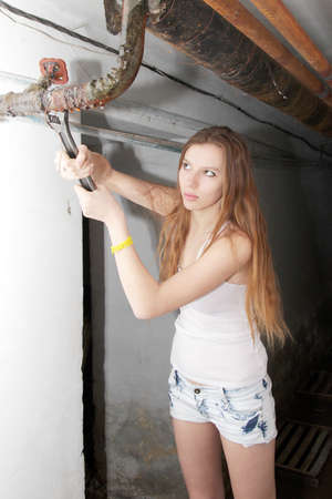 beautiful girl will use for repair wrench Stock Photo - 12933232