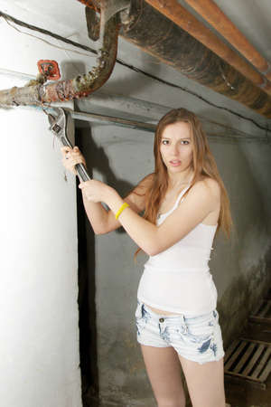 beautiful girl will use for repair wrench photo
