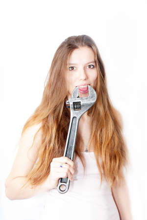 beautiful girl keeps in the hands wrench  Stock Photo