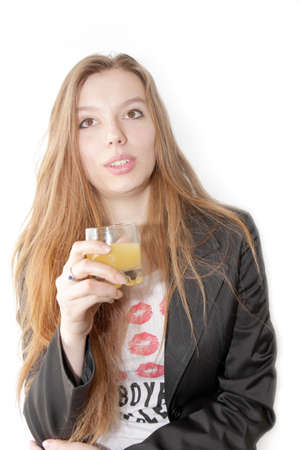 making look younger girl with glass juice in hand Stock Photo - 13048506