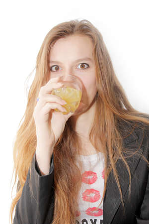 beautiful making look younger girl with glass juice in hand Stock Photo - 13040717