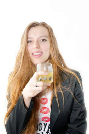 making look younger girl with glass juice in hand Stock Photo - 13048362