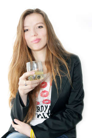 making look younger girl with glass juice in hand Stock Photo - 13048538