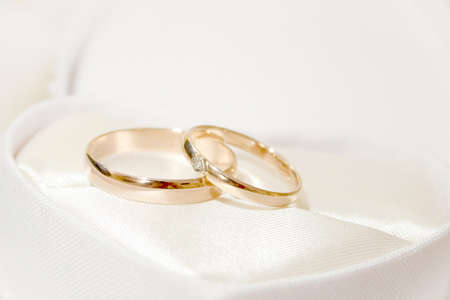 2 objects: scene two rings as symbol holiday wedding ceremony