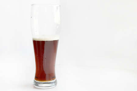 spume: scene spume on surface dark beer in glass