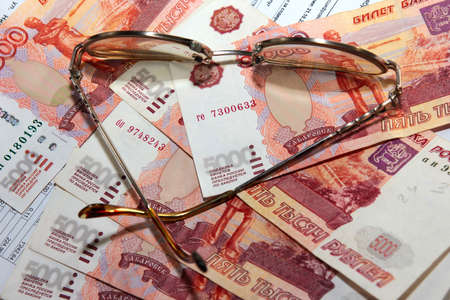 scene several thousand rouble and old spectacles for correcting the vision Stock Photo - 16366329