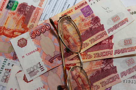 scene several thousand rouble and old spectacles for correcting the vision Stock Photo - 16366327