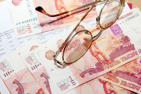 scene several thousand rouble and old spectacles for correcting the vision Stock Photo - 16366326