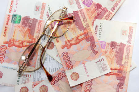 scene several thousand rouble and old spectacles for correcting the vision Stock Photo - 16366325